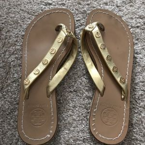 Tory Burch gold flip flops